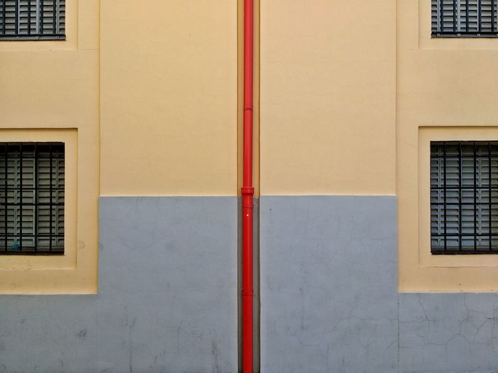 Red Pipe Building Colors Windows Geometry Wall Pale Colors Vertical Line Eyeemphoto The Architect - 2017 EyeEm Awards Neighborhood Map Places Of Alcalá De Henares The Graphic City