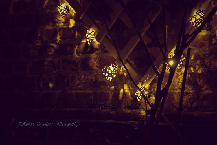 Illuminated lighting equipment on wall in building