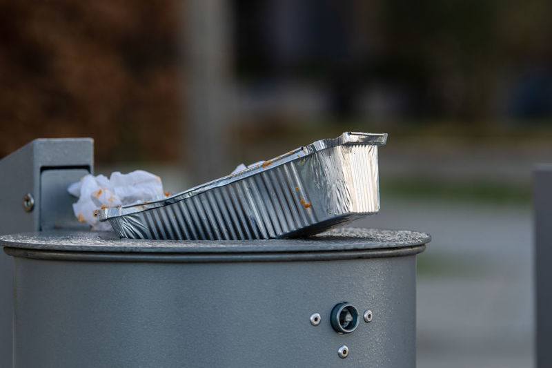 Close-up of silver container in garbage bin