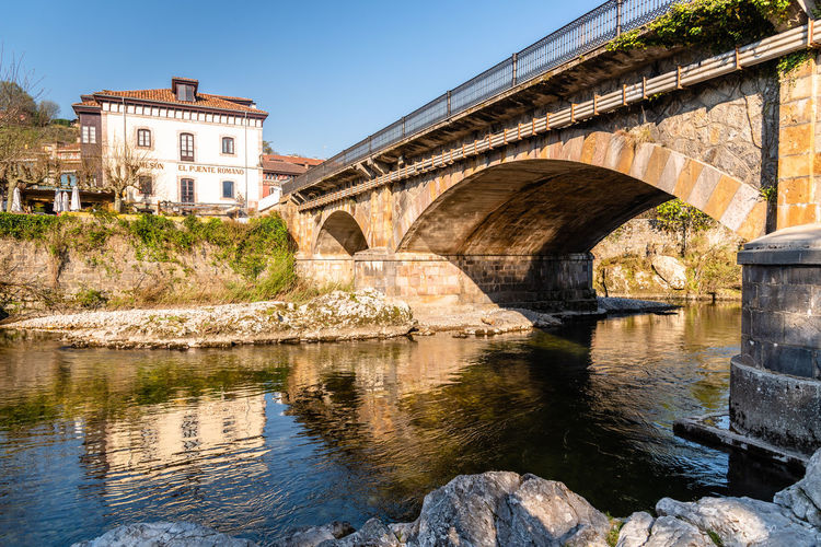 Bridge in Cangas de Onis in Asturias Built Structure Architecture Water Bridge Building Exterior Bridge - Man Made Structure River Connection Nature Arch Sky Day Reflection Transportation Arch Bridge Old Building No People History Outdoors Architectural Column Asturias Cangasdeonis Cangas
