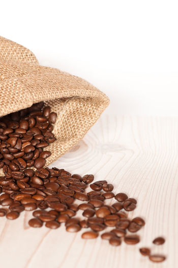 Beans Coffee Coffee Time Copy Space Background Brown Close-up Coffee Bean Coffee Beans Food Food And Drink Freshness Indoors  No People Raw Coffee Bean Roasted Coffee Bean Sack Still Life Table White Background White Color