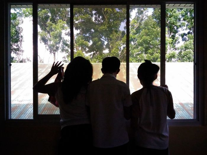 Looking at the window Candid Portrait Looking Candid School Photography Taking Photos Phoneography Asus Photography Asus Zenfone Photography Window View Looking At The Window Looking Outside Trees Roof Silhoutte Photography Silhouette