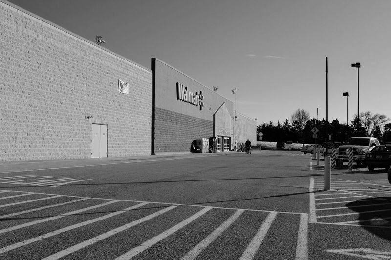 Visual Journal December 2016 Southeast Nebraska (Fujifilm X100s) edited with Google Photos. B&W Collection B&w Photography B&w Street Photography Big Box Store Blackandwhite Building Exterior Built Structure Composition Department Store Everyday Lives EyeEm Gallery Fuji X100s Outdoors Parking Lot People Of Wal Mart Photo Diary Photo Essay Rural America Small Town Stories Taking Photos Visual Journal Walmart Winter