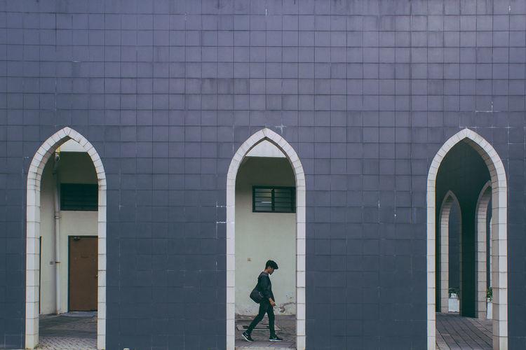 Silhouette of girl walking in building