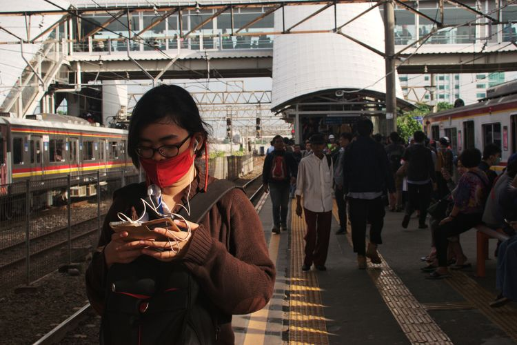 Jakarta, January 2017 Streetphotography Documentaryphotography Train Train Station Commuting Commuter Commute Only Women Adult Adults Only One Woman Only One Person Business Finance And Industry People Lifestyles Women Standing Wireless Technology City Outdoors Day Young Adult One Young Woman Only The Street Photographer - 2018 EyeEm Awards