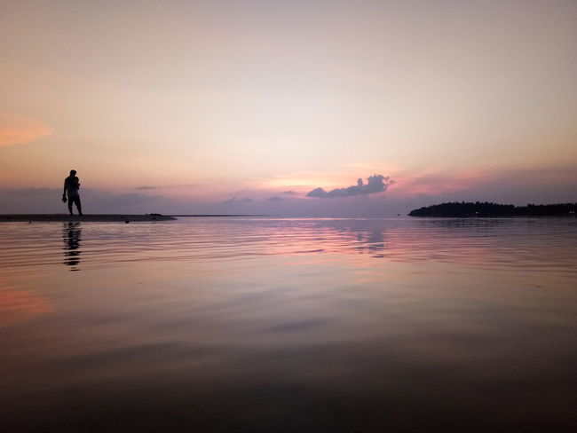 EyeEm Selects Water Sunset Swimming Full Length Beach Low Tide Beauty Lake Child Silhouette