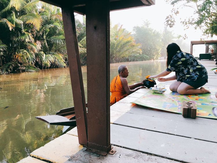 Make merit in the morning 🙏🏻 Riverside Boat Merit Temple Morning Green Color Thailand Asian  ASIA Ecclesiastic Monk  Buddhism Buddha Lotus One Person Real People Lifestyles Side View Child Sunlight Outdoors Casual Clothing Women Tree Plant Sitting Girls Childhood Nature EyeEmNewHere