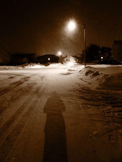 View of illuminated street lights at night