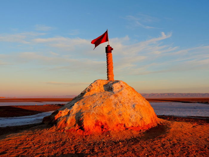 Sky Water Sunset Cloud - Sky Sea Land Rock Nature Beauty In Nature Beach Scenics - Nature Orange Color Rock - Object No People Solid Guidance Tranquility Tranquil Scene Red Outdoors