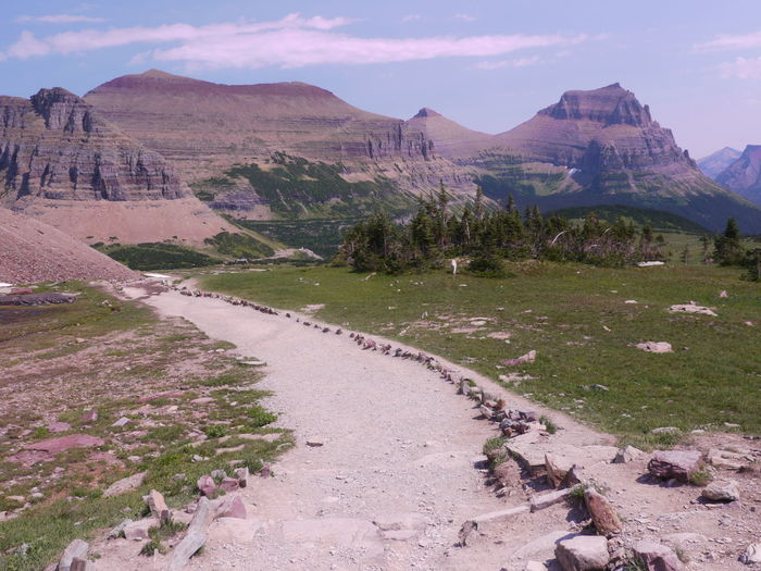 Trail at Logan Pass in Glacier National Park, Montana, United States. Mountain Scenics - Nature Tranquil Scene Beauty In Nature Sky Tranquility Environment Nature Landscape No People Non-urban Scene Rock Mountain Range Day Geology Travel Destinations Land Plant Cloud - Sky Remote Outdoors Arid Climate Mountain Peak