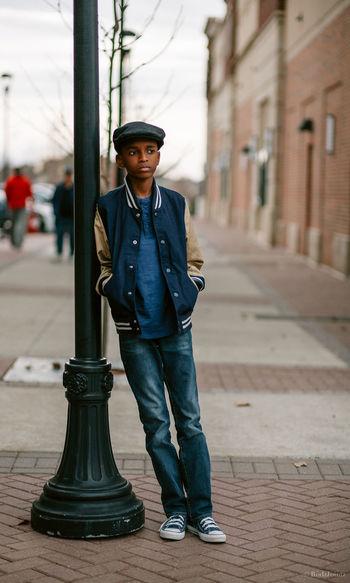 Full length portrait of man in city