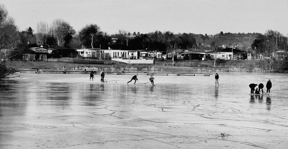 Winter Fun Sunny Winter Day Frozen Lake Playing Ice Hockey Lifestyles Playing Competitive Sport Large Group Of People Real People Leisure Activity Sport Outdoor Fun Black And White Black And White Photography Nature Landscapes Lakeside Lake View Outdoors Teamwork Ice Rink Tree Langenselbold Germany🇩🇪 Every Picture Tells A Story Live For The Story The Photojournalist - 2018 EyeEm Awards