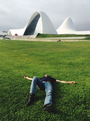 I Young Adult Person Exercising Relaxation Baku Lying On Back Sky Green Color Enjoyment