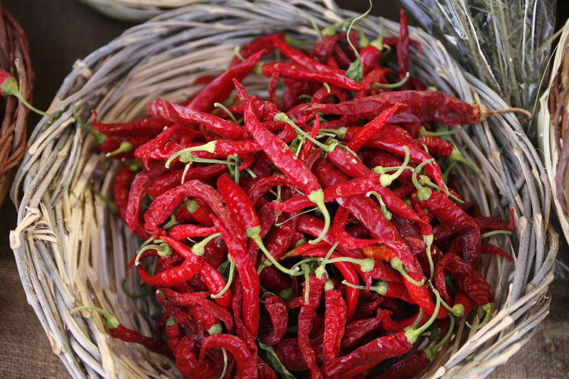 High Angle View Of Red Chili Peppers In Basket