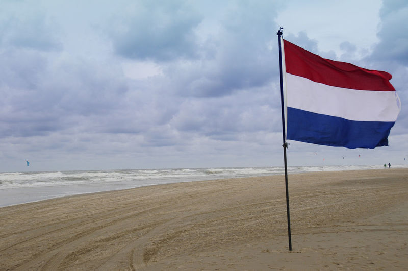 Netherlands Beach Beauty In Nature Cloud - Sky Day Environment Flag Horizon Horizon Over Water Land Nature No People Outdoors Patriotism Sand Scenics - Nature Sea Sky Tranquility Water Wind