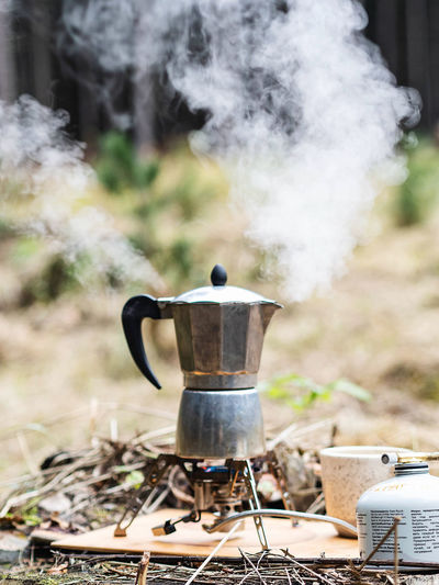 Making coffee outdoors in a metal coffee pot
