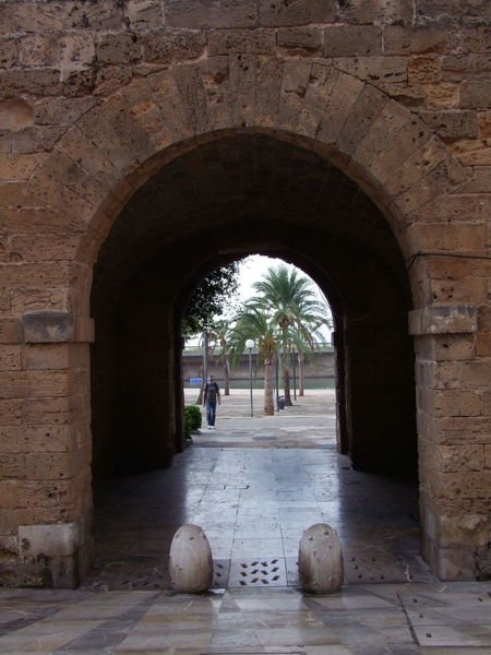Walkway through City Walls, Palma City City Walls Composition Entrance Mallorca Palma Palma De Mallorca SPAIN Seeing The Light Tourist Attraction  Ancient Walls Arch Architecture Building Exterior Capital City Famous Place Full Frame History Looking Through No People Outdoor Photography Palm Tree Thick Walls Travel Destination Walkway