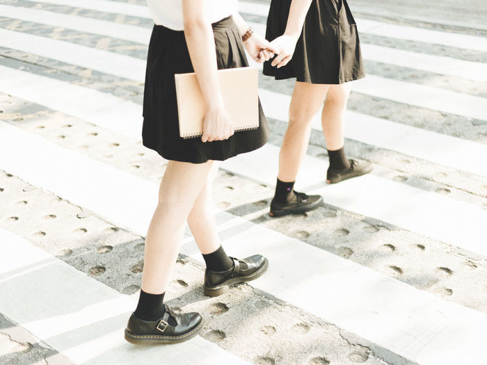 Low section of friends crossing road