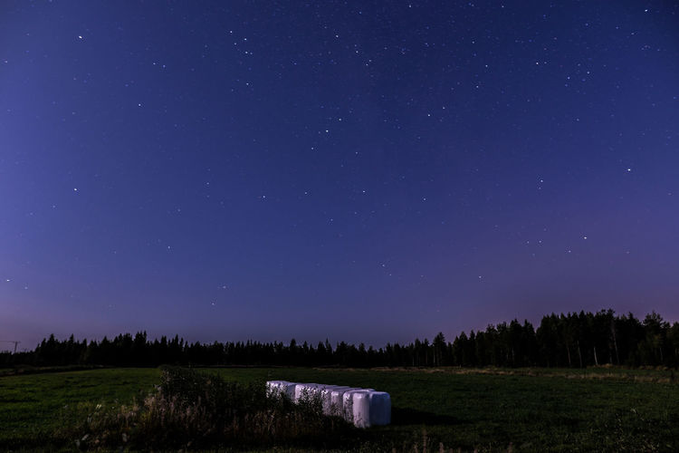 Countryside in the moonlight Agriculture Finland Hay Bale Lapland Astronomy Beauty In Nature Environment Field Idyllic Land Landscape Moonlight Nature Nature_collection Night No People Photography Plant Scenics - Nature Sky Space Star - Space Star Field Tranquil Scene Tranquility