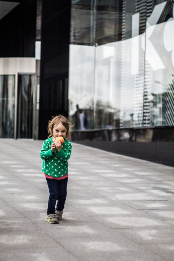 Architecture Building Exterior Built Structure Casual Clothing Child Childhood City Day Females Girls Hairstyle Innocence Lifestyles One Person Outdoors Real People Standing
