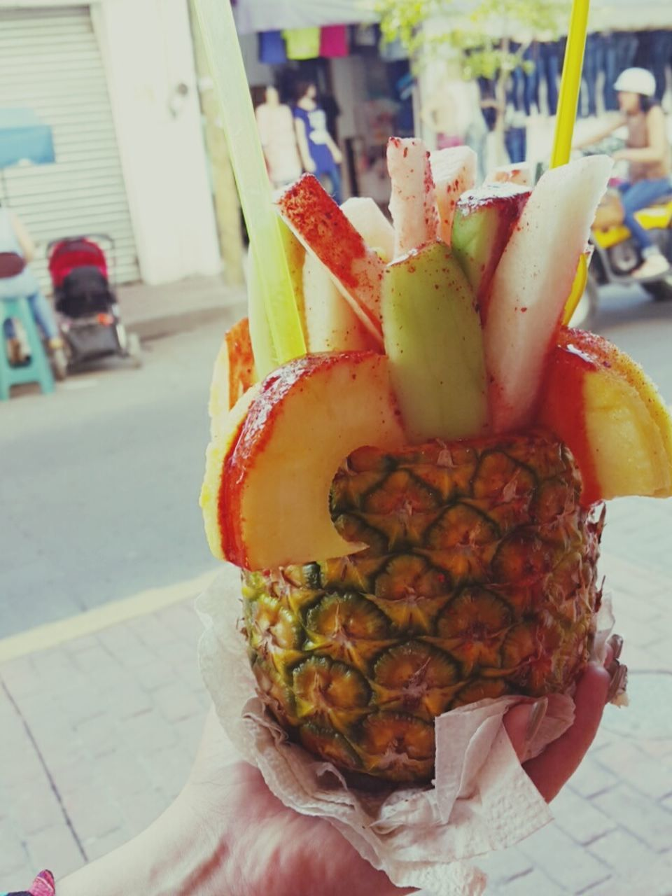 human hand, human body part, food and drink, real people, one person, food, holding, focus on foreground, freshness, close-up, lifestyles, outdoors, day, sweet food, ready-to-eat, fruit, healthy eating, men, building exterior, people