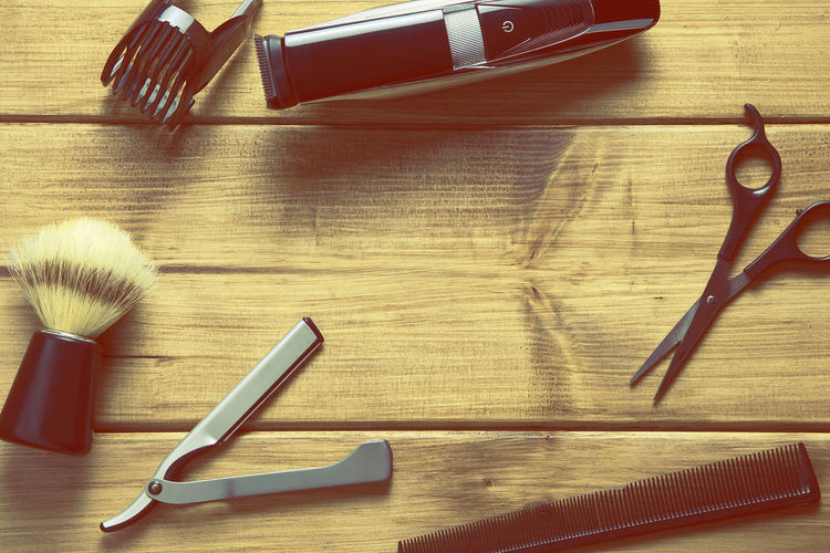 Directly above shot of shaving equipment on wooden table