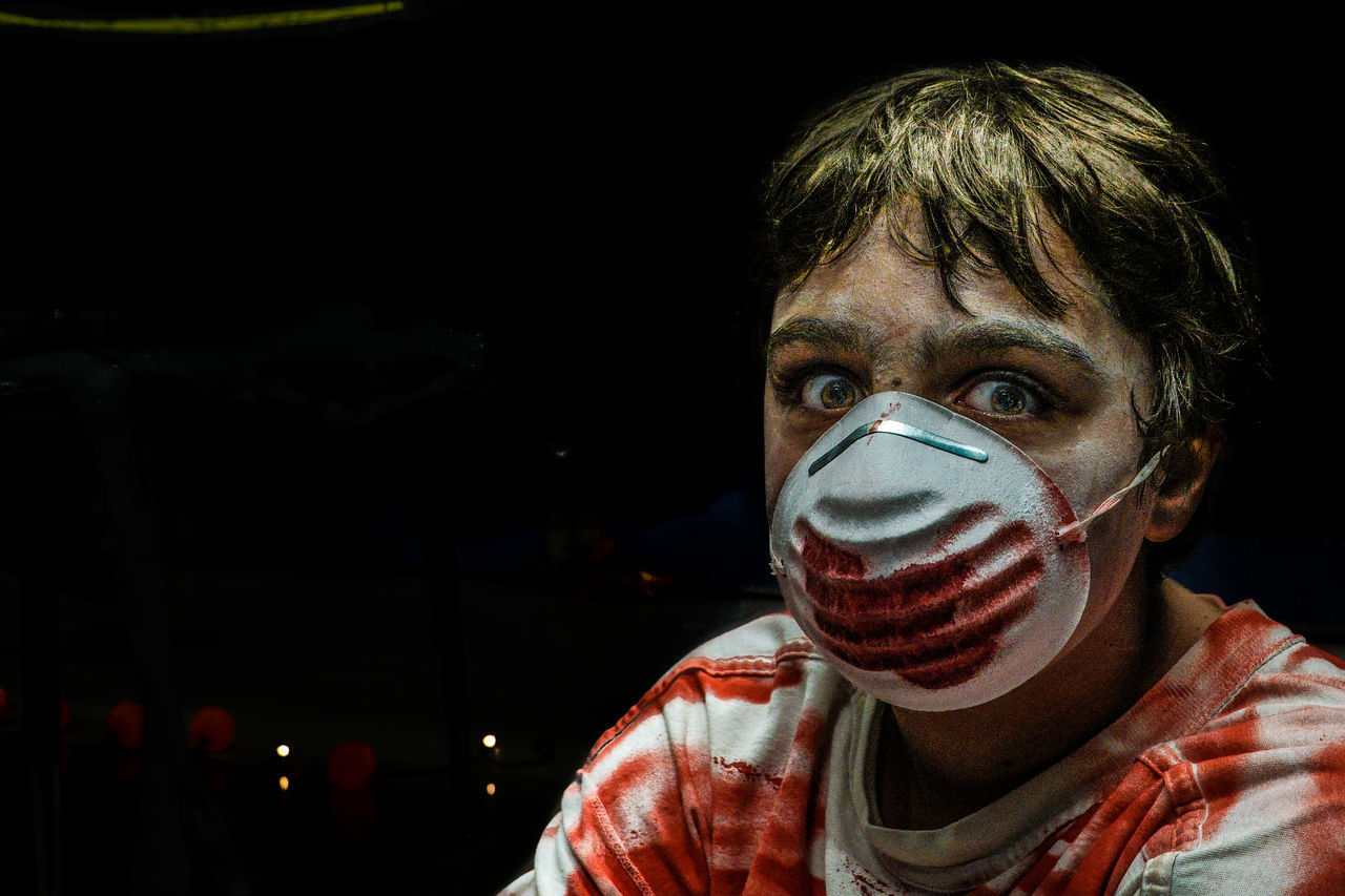 Portrait Of Man With Surgical Mask During Halloween