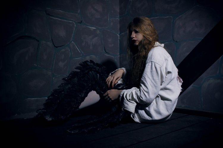 Woman Sitting In Darkroom