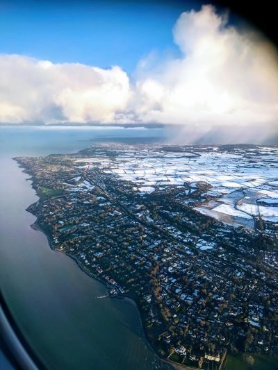 Sea Water Cloud - Sky Travel Sky Blue No People Mobilephotography Airplane Plane Window Window Dramatic Sky Snow ❄ Lovephotography  Aerial View Plane Journey Winter Frozen Beauty In Nature Clouds And Sky Colors The Traveler - 2018 EyeEm Awards