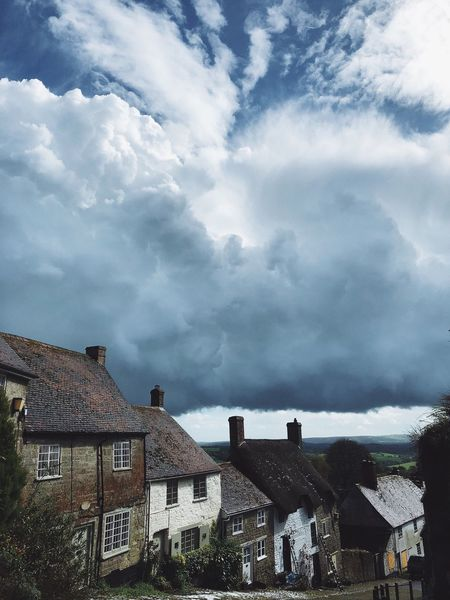 Crazy weather here in England England Uk Cloud - Sky Architecture Building Exterior Built Structure Sky Building No People Nature Low Angle View City Residential District House Day Tree Outdoors Roof Plant Town Travel Destinations