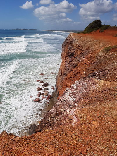 Red Cliff Natur Is Beautiful Beauty In Nature Red Ocean Cliff Water Sea Beach Sand Wave Sky Horizon Over Water Cloud - Sky Landscape Rocky Coastline Coast Coastline Rock Formation Rock