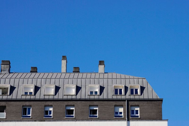 Chimney on the rooftop of the house, architecture in bilbao city, spain