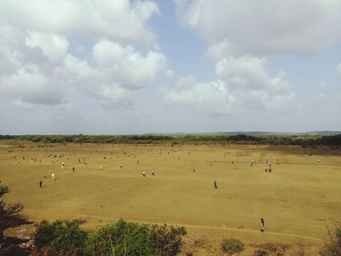 People on field against sky