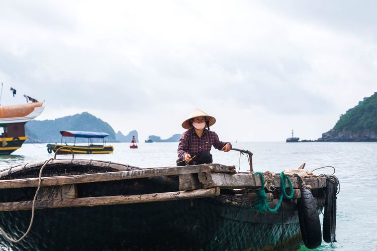 Boat Real People Mode Of Transport Working Hard Culture One Person Tires Old Boat Old Ways Rice Hat Vietnam Bay Driving Hard Working Women Tradition Way Of Life Amazing Family Water Sea