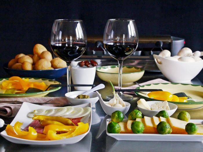 Mushrooms Red Wine In The Glas Bowl Bowls Brusslesprouts Cheese Choice Close-up Dinner Table Food Food And Drink Freshness Fruit Healthy Eating Indoor Grill Indoors  No People Plate Potatoes Raclette Cooking Ready-to-eat Table Variation