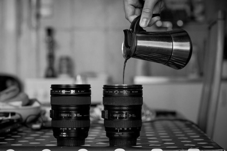 Cropped Image Of Man Pouring Coffee In Mug On Table