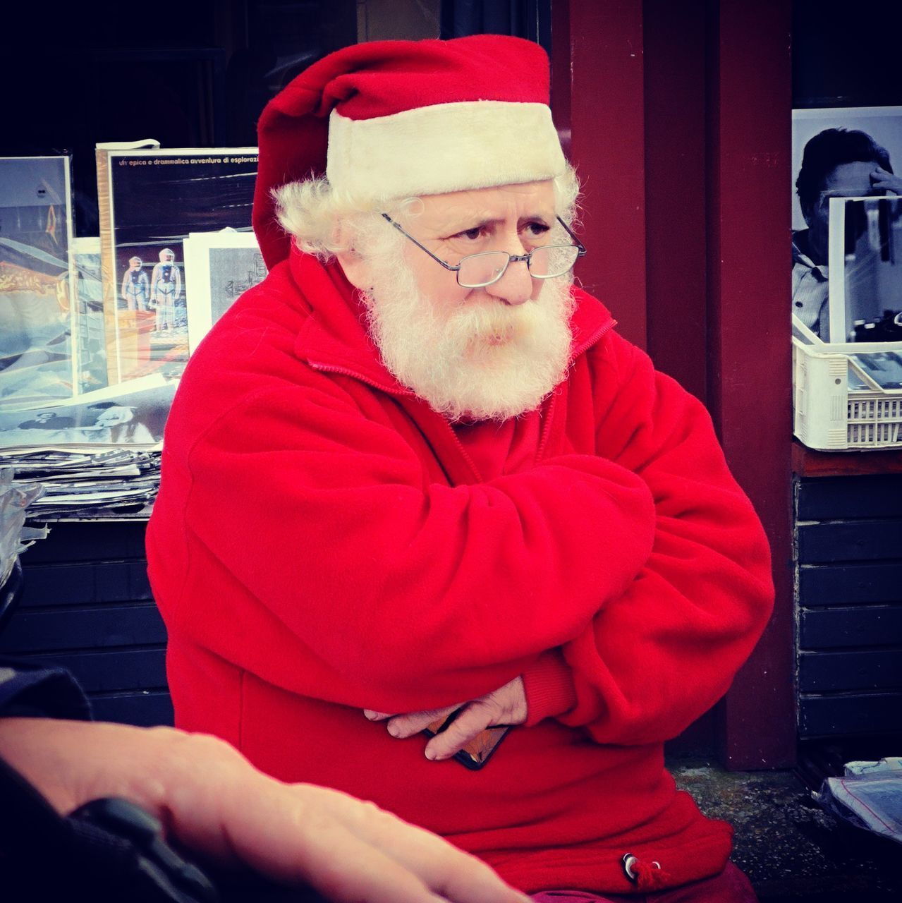 males, men, one person, real people, adult, glasses, lifestyles, red, clothing, beard, eyeglasses, facial hair, hat, waist up, santa claus, sitting, front view, leisure activity, warm clothing, mature men