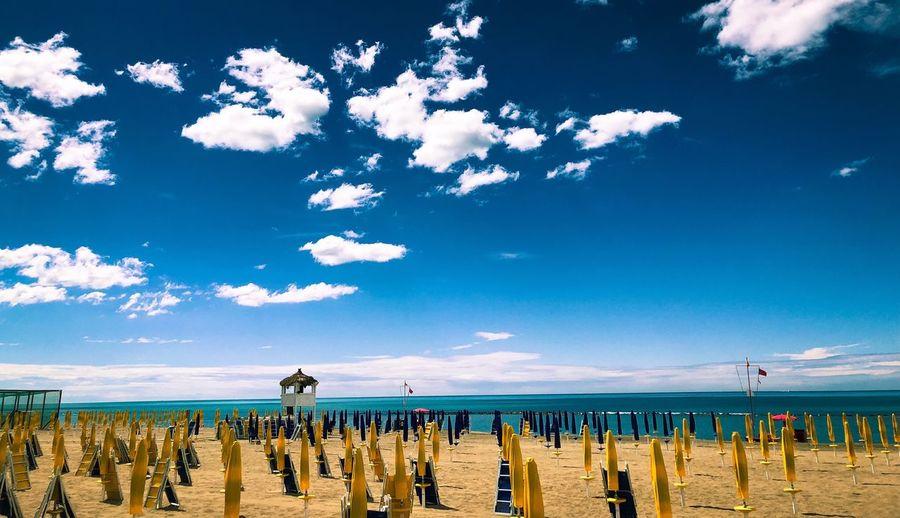 Clouds Sky Cloud - Sky Beach Sea Water Land Horizon Over Water Nature Scenics - Nature Beauty In Nature Horizon Tranquility Blue Idyllic Tranquil Scene Sand Outdoors No People Umbrella Day