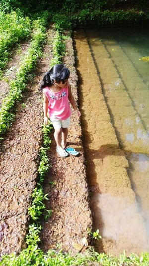 Shadow Childhood High Angle View Full Length Day Sunlight Outdoors Grass One Person Leisure Activity Real People Girls Children Only Lifestyles Water Child People