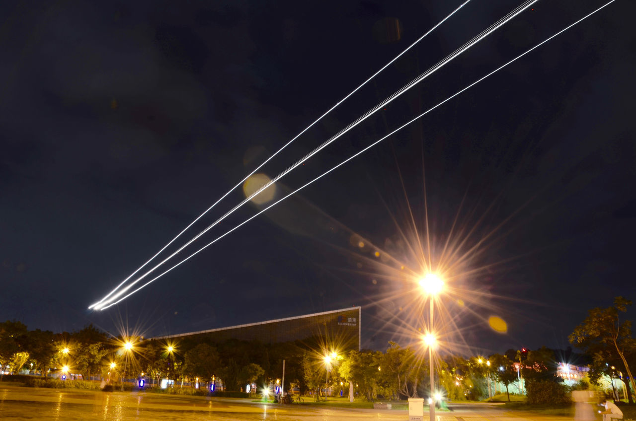 night, illuminated, sky, outdoors, transportation, low angle view, built structure, no people, architecture, nature, vapor trail, city