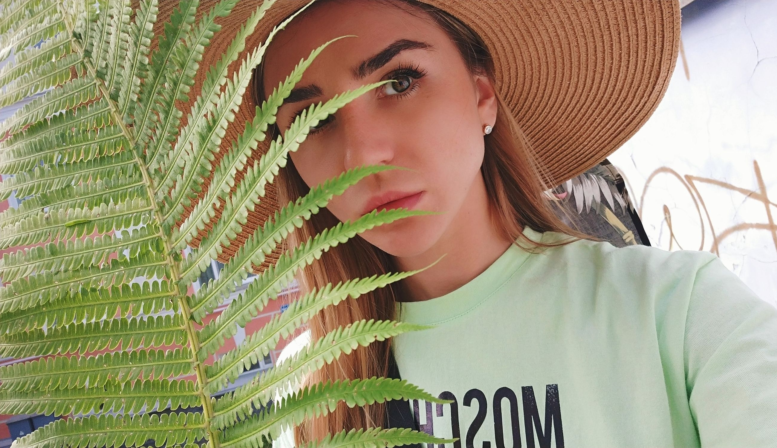 one person, headshot, hat, portrait, lifestyles, front view, real people, leisure activity, women, young adult, clothing, looking, close-up, casual clothing, young women, adult, day, looking away, beautiful woman, human face, contemplation