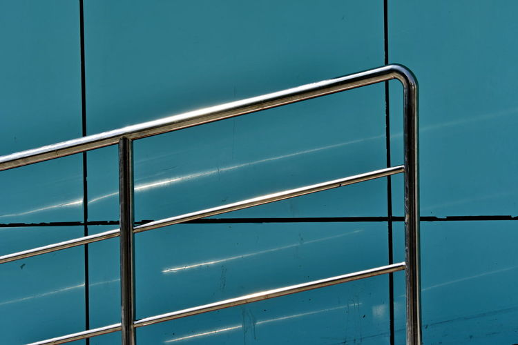 Low angle view of metal railing against building