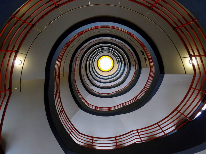 Directly Below Shot Of Illuminated Spiral Staircases