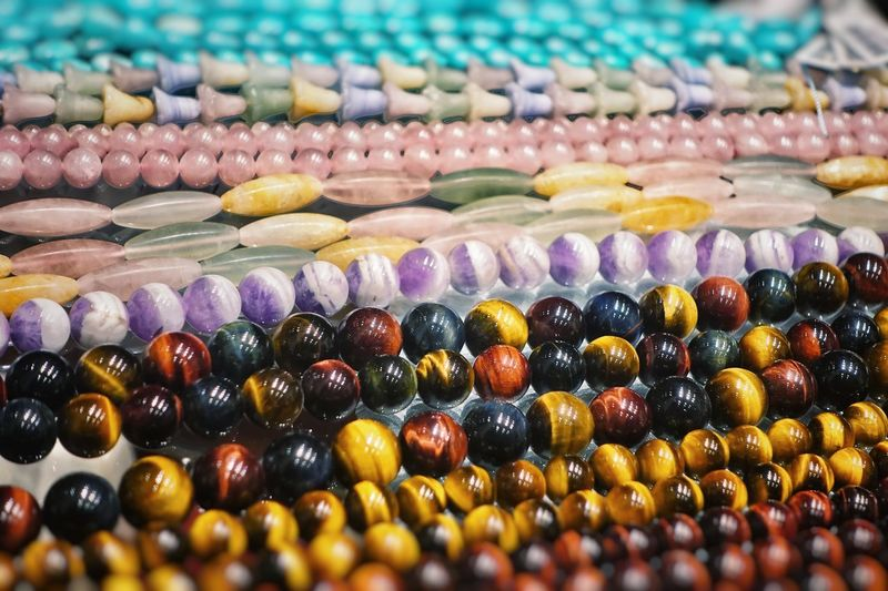Choice Retail  Multi Colored Large Group Of Objects Variation No People For Sale Abundance Wellbeing Still Life Close-up Arrangement Order Bead Beads Natural Semiprecious Stones Semipreciousstones Pattern Textured  Row Blackandwhite Pink Color Blue Yellow Raw Various Stall Repetition Variety