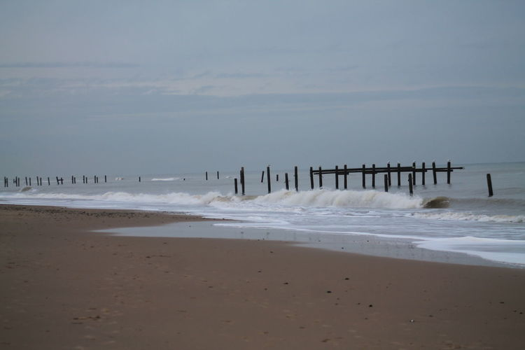 Beach Beauty In Nature Day Groynes Nature No People Norfolk Coast Outdoors Scenics Sea Sky Structures In The Sea Water