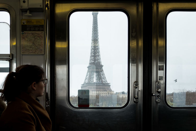 Woman Looking At Eiffel Tower Through Train Window