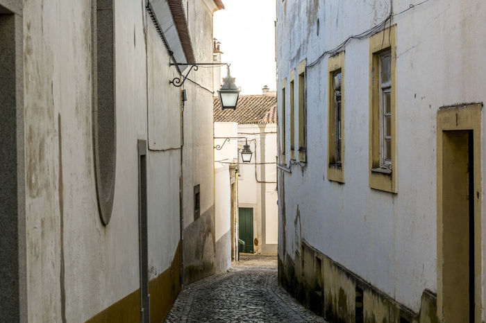 Ancient town Evora in Portugal, architecture of medieval times Alley Architecture Building Exterior Built Structure Day House No People Outdoors Residential Building Sky The Way Forward Window