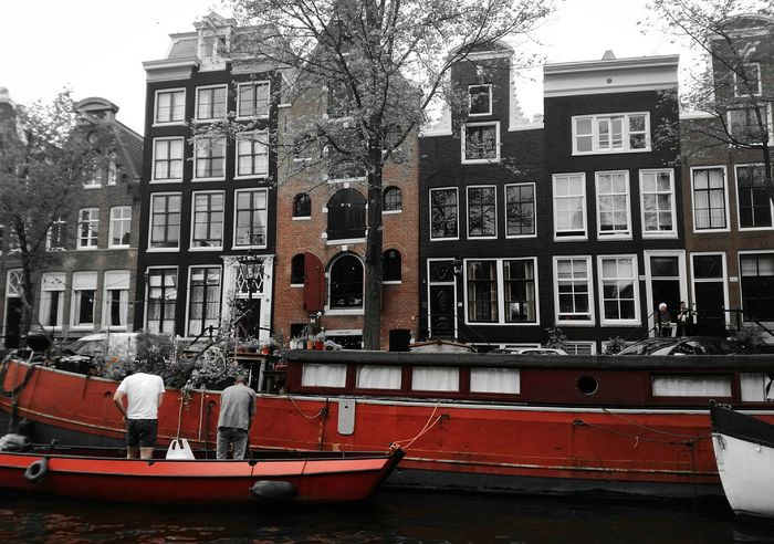 Exploring Amsterdam from boat ❤👌 Architecture Building Exterior Window Outdoors Day Boathouse Boats Sky Netherlands Europe Explore Amsterdamthroughmycamera Amsterdam NewEyeEmPhotograph Cityscape Netherland Fietsen EyeEmNewHere Dutch Architecture Architecture Bike People Shadow Red Balckandwhite