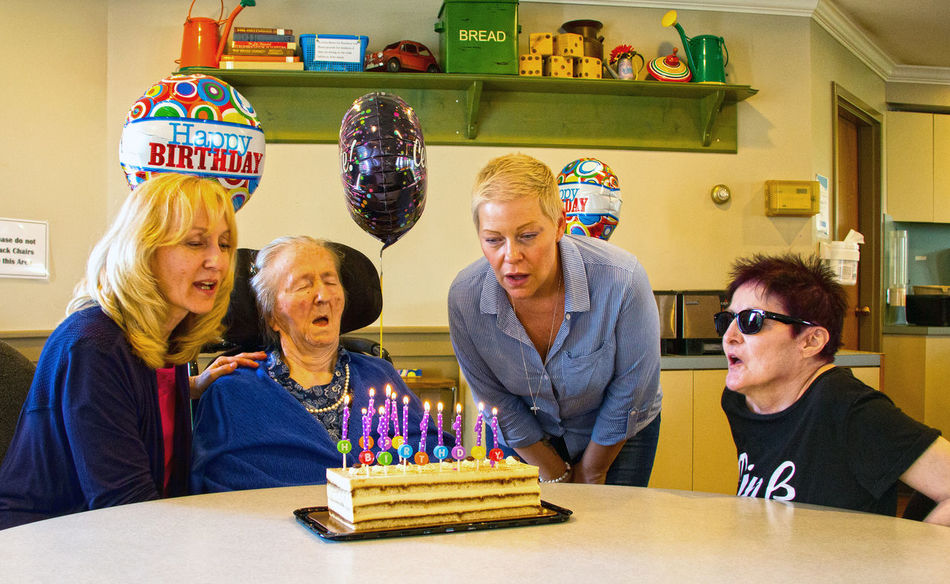 Happy birthday at Pinegrove Care Home Richmond BC The Photojournalist - 2018 EyeEm Awards Birthday Cake Birthday Sitting Life Events Birthday Candles Flame Celebration Men Table Togetherness Senior Couple Retirement Community One Senior Woman Only 80-89 Years Silver Surfer Senior Women