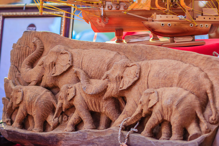 Beautiful Wood carving of elephant family. Antique Art Handmade Furniture which Carvings Elephant Family in The Wood. Elephant wooden crafted for sale in the local market at Northern Thailand. Elephant Family Souvenir Shop Animal Themes Antique Art Close-up Day Elephant For Sale Hand Made Jewelry Handmade Indoors  No People Sculpture Souvenir Statue Wood - Material Wood Carver Wood Carving Wood Carving Art